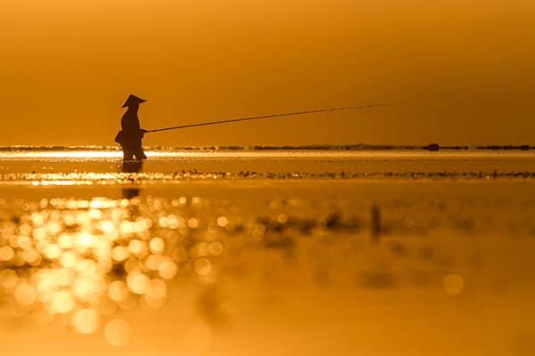 1 J'ai pris cette photo au lever de soleil à Bali, un pêcheur. Canon 6D, Canon 70-200 f/2.8 IS II USM L, f/8, 1/3200s et 160 ISO